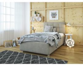 Самодостаточная односпальная кровать Sabina с минимальным декором изголовья в виде стёжки.